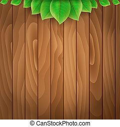 Green leaves on wooden background