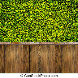 Green leaves wall and wood fence for background