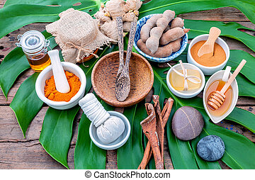 Green leaves with nature spa ingredient turmeric powder in...