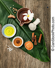 Green leaves with nature spa ingredients turmeric