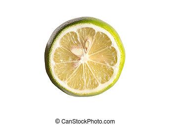 Green lemon cut half slice isolated on white background