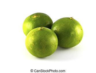 Green lemons and fresh ripe lemon isolated on white background.