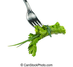 Green lettuce leaf with parsley on a fork isolated on white...