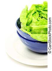 Green lettuce leaves in a bowl