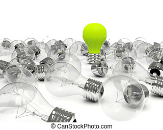 Green light bulb in a pile of bulbs