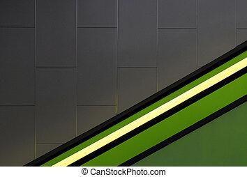 Green light on a gray wall.