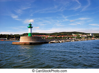 Green lighthouse on breakwater in Sassnitz, Germany