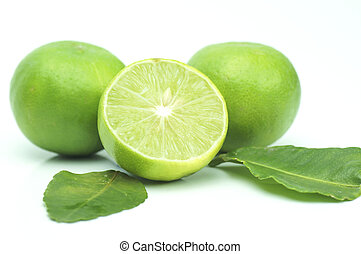 green lime with leaves isolated on white background