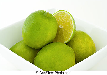 Green limes in a bowl