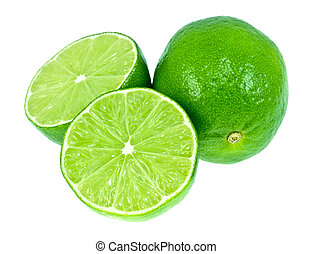 Green Limes - Two green limes. One is cut in half. Very...