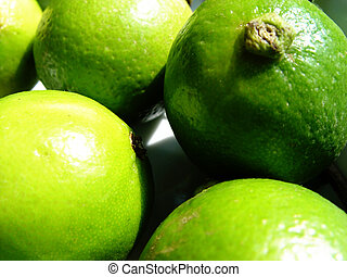 green limes waiting to become a caipi