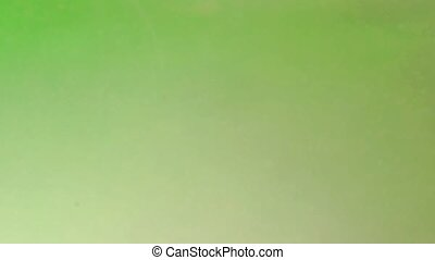 Green liquid background with bubbles. Abstract background