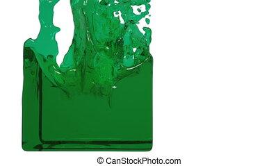 green liquid fills up a container. clear liquid