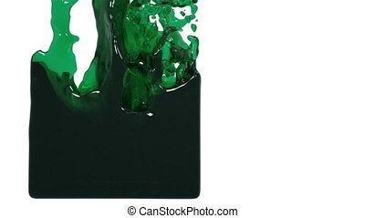 green liquid fills up a container. oil