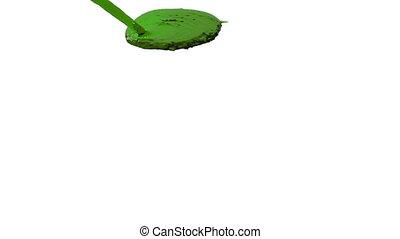 green liquid flow falls on surface