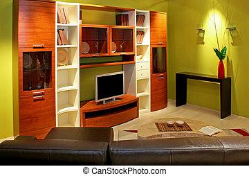 Green living angle - Green living room with big shelf for TV...