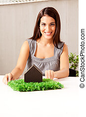 Green Living Concept - A design professional showing a green...