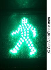 Green man go pedestrian traffic light sign