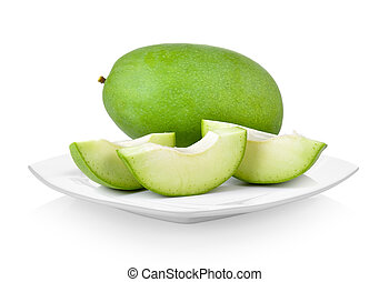 green mango in white plate on white background