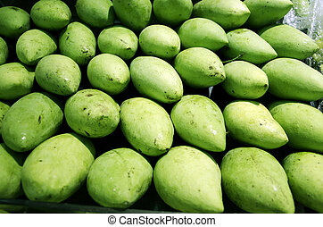 Green mango. - The mangoes piled together.