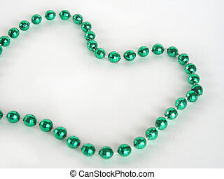 Green Mardi Gras bead - Close up of green mardi gras bead