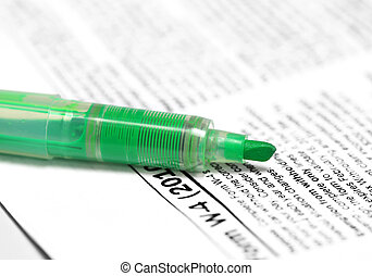 Green marker on W4 form - Close up shot of a green marker on...