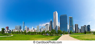 Green meadow on cityscape background of Chicago