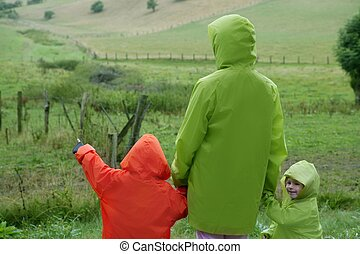 Green meadow with waterproof colorful coat