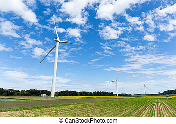 Green meadow with Wind turbines