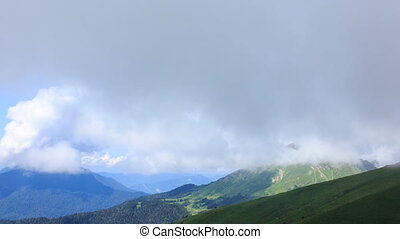 Green meadows under the clouds. Zoom. Time Lapse, Sochi, Russia