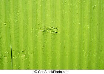 Green metal surface with worn paint