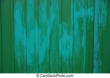 green metal texture with a stain of paint on an iron wall