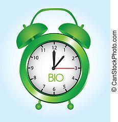 alarm clock - green metallic alarm clock over blue ...