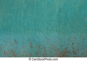 green metallic texture on an old wall with rust