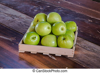 Green monkey apple in the box put on wooden table