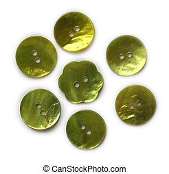 Green mother of pearl buttons isolated on white background.