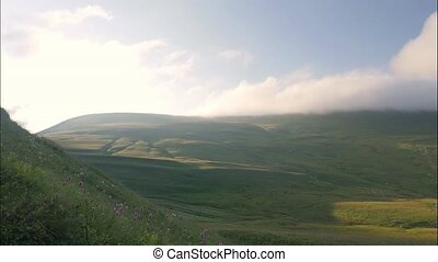 Green mountain and valley landscape timelapse. Highlands and...