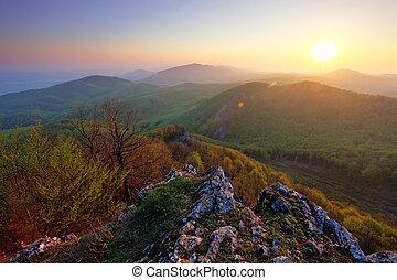 green mountain at sunrise