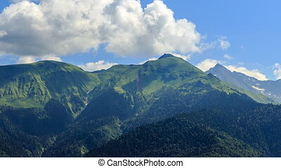 Green Mountains in the clouds. HDR. Time Lapse. Sochi,...