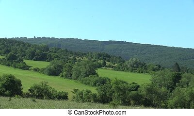 Green mountains meadows, blue sky and forest, White Carpathians Czech