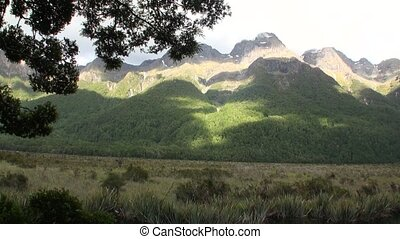 Green mountains panorama in sunlight of New Zealand.