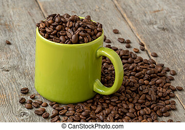 Green mug with coffee beans