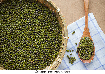 green mung beans over the wooden spoon
