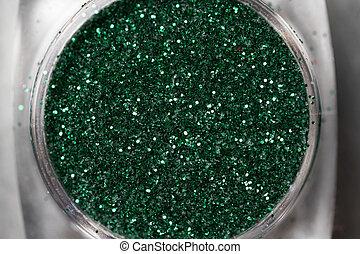 Green nail makeup glitter - Closeup of green nail makeup...