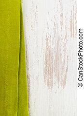 green napkin on white wooden background