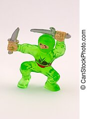 Green toy ninja isolated on white background