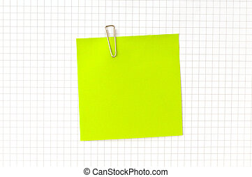 Green note with clip on the paper