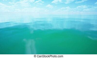 green ocean with sunlight