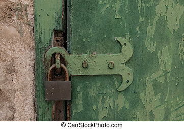 green old door with a lock