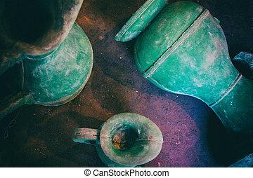 Green old vintage vases on the floor.